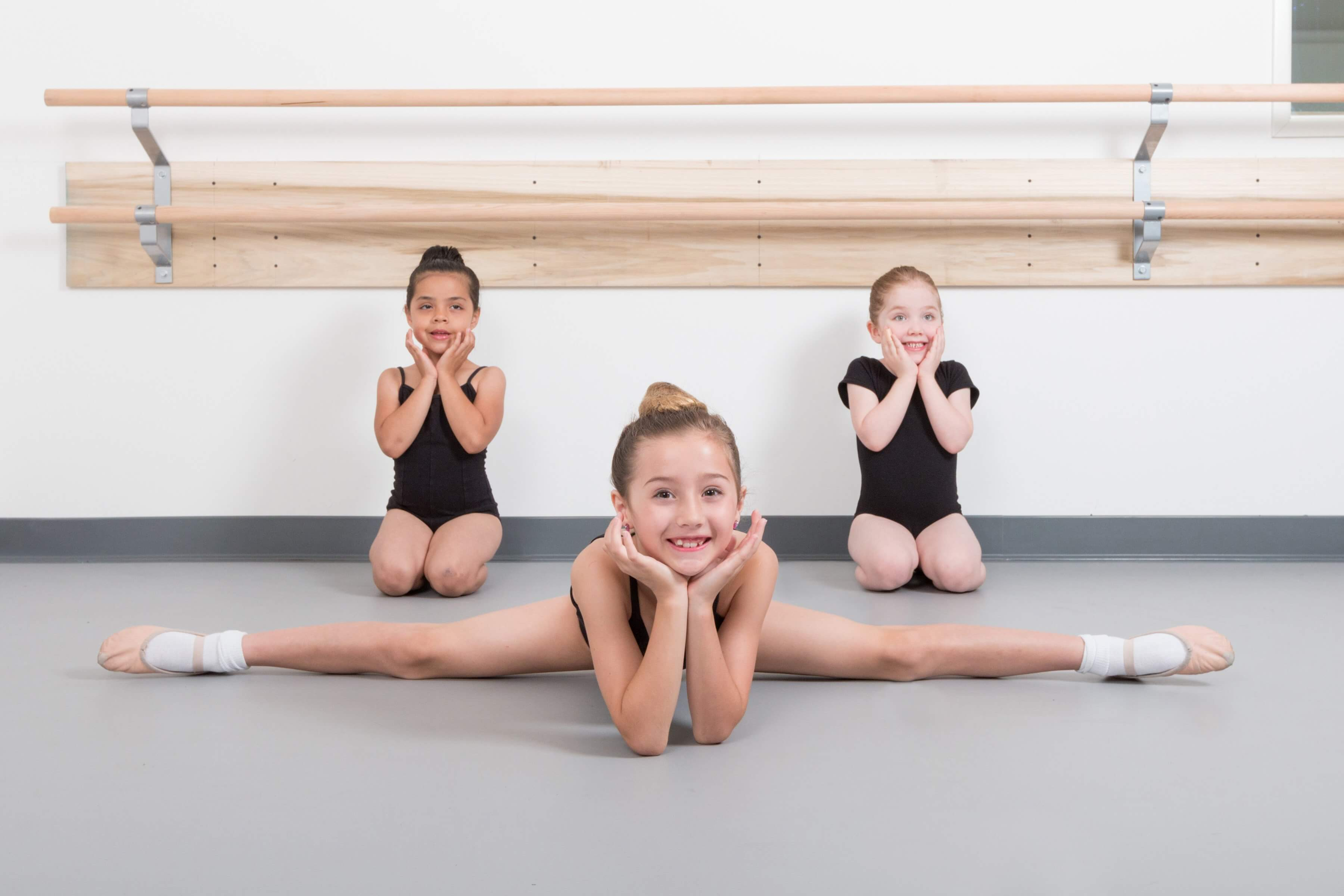 Three ballet dancers students welcome you